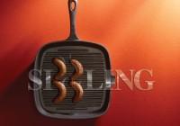 Studio shot of sausages in griddle pan